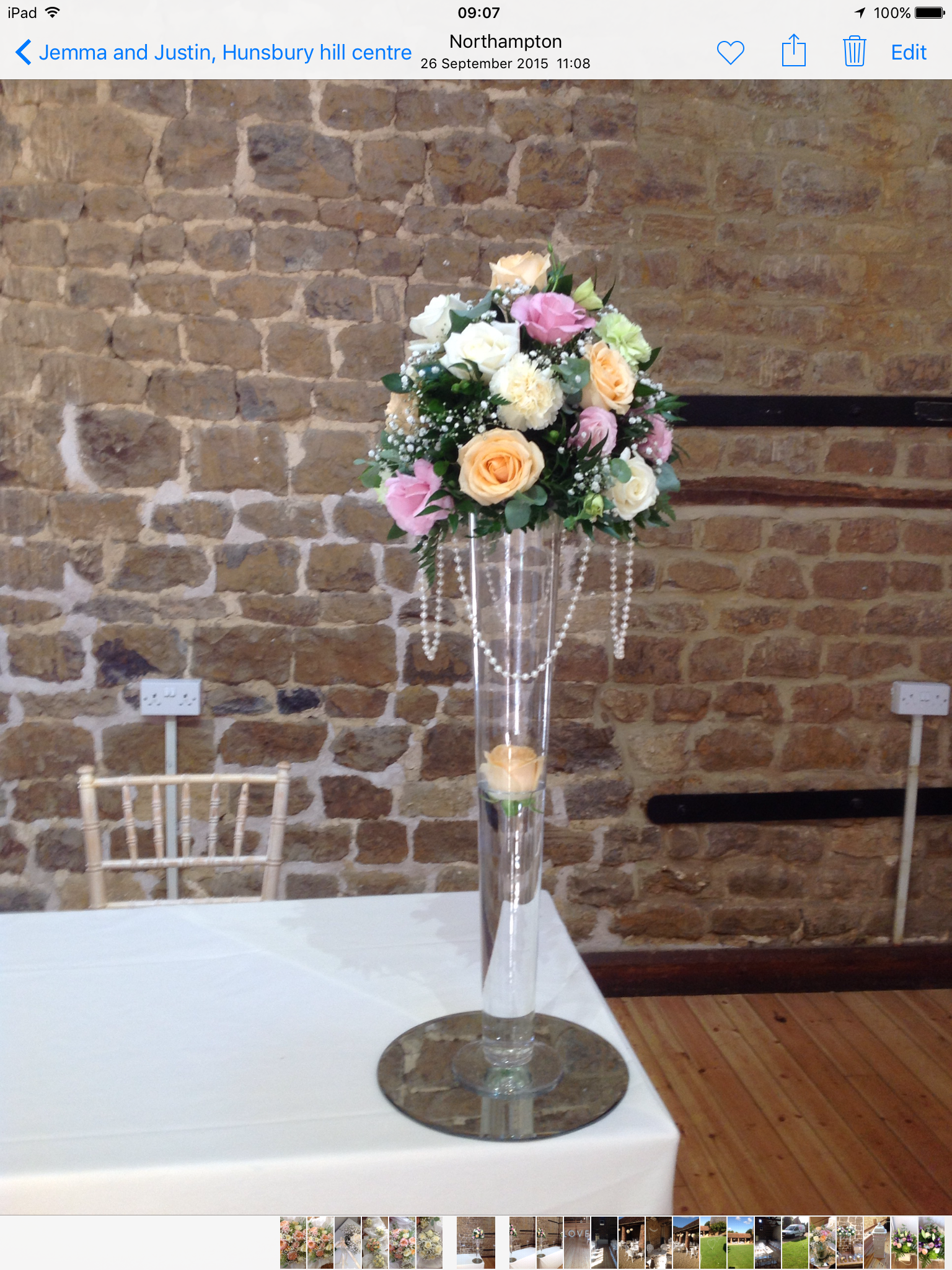 Pretty pastel arrangement on top of the tall conical vase the