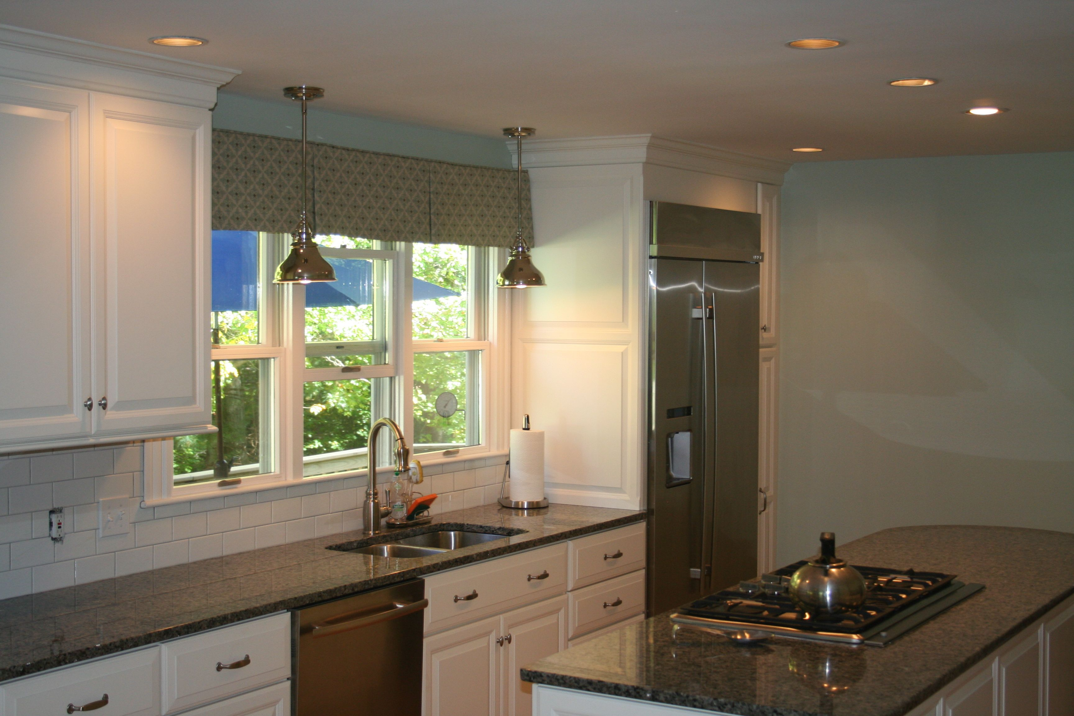 Candlelight Cabinetry In Aurora White Granite Island Countertop With Cooktop Stainless Steel App Island Countertops Candlelight Cabinetry Kitchen Inspirations