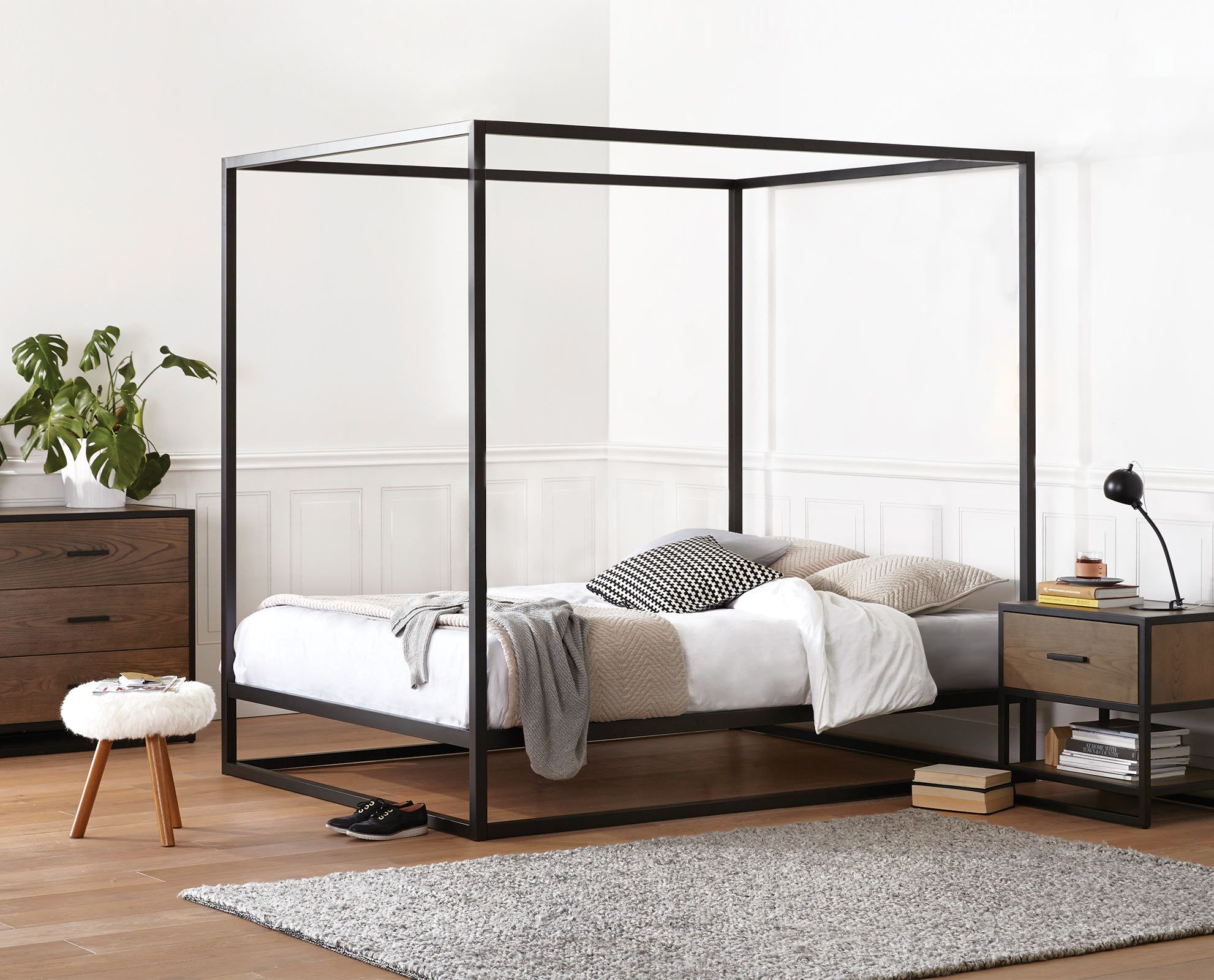 Scandinavian Designs - Enjoy the romantic style of the Oppet canopy bed,  adding height and
