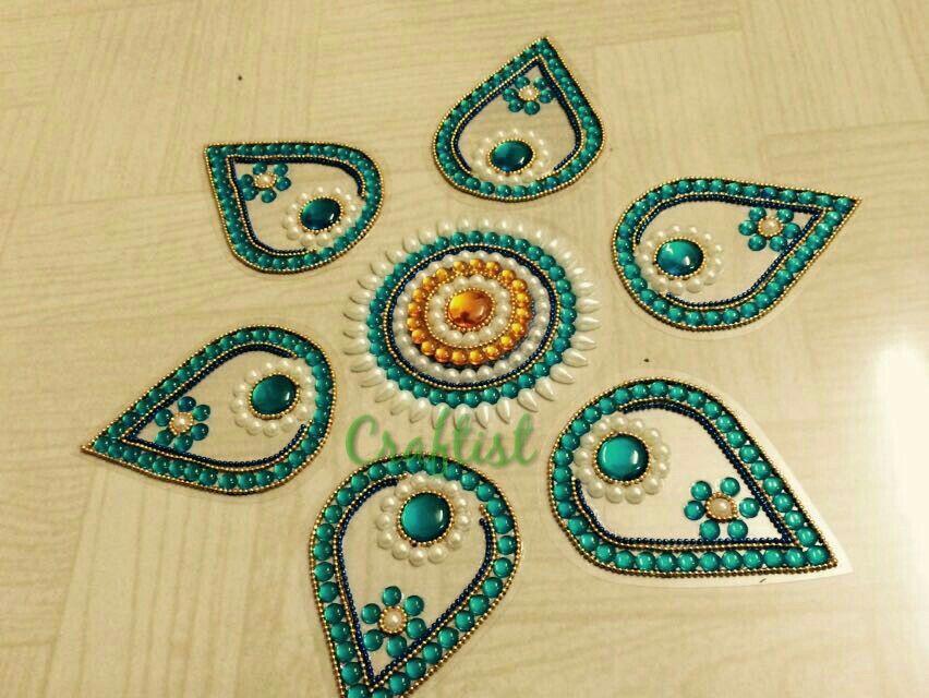 Blue drops 225 Rs..  6 drop shapes & 2 middle Material ohpiecesp sheet & kundan