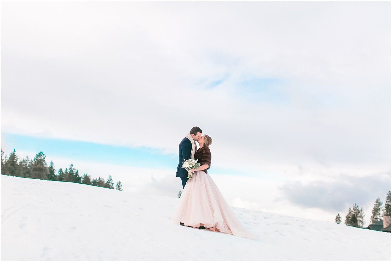 Blush wedding dress in the snow nothing better snowy wedding