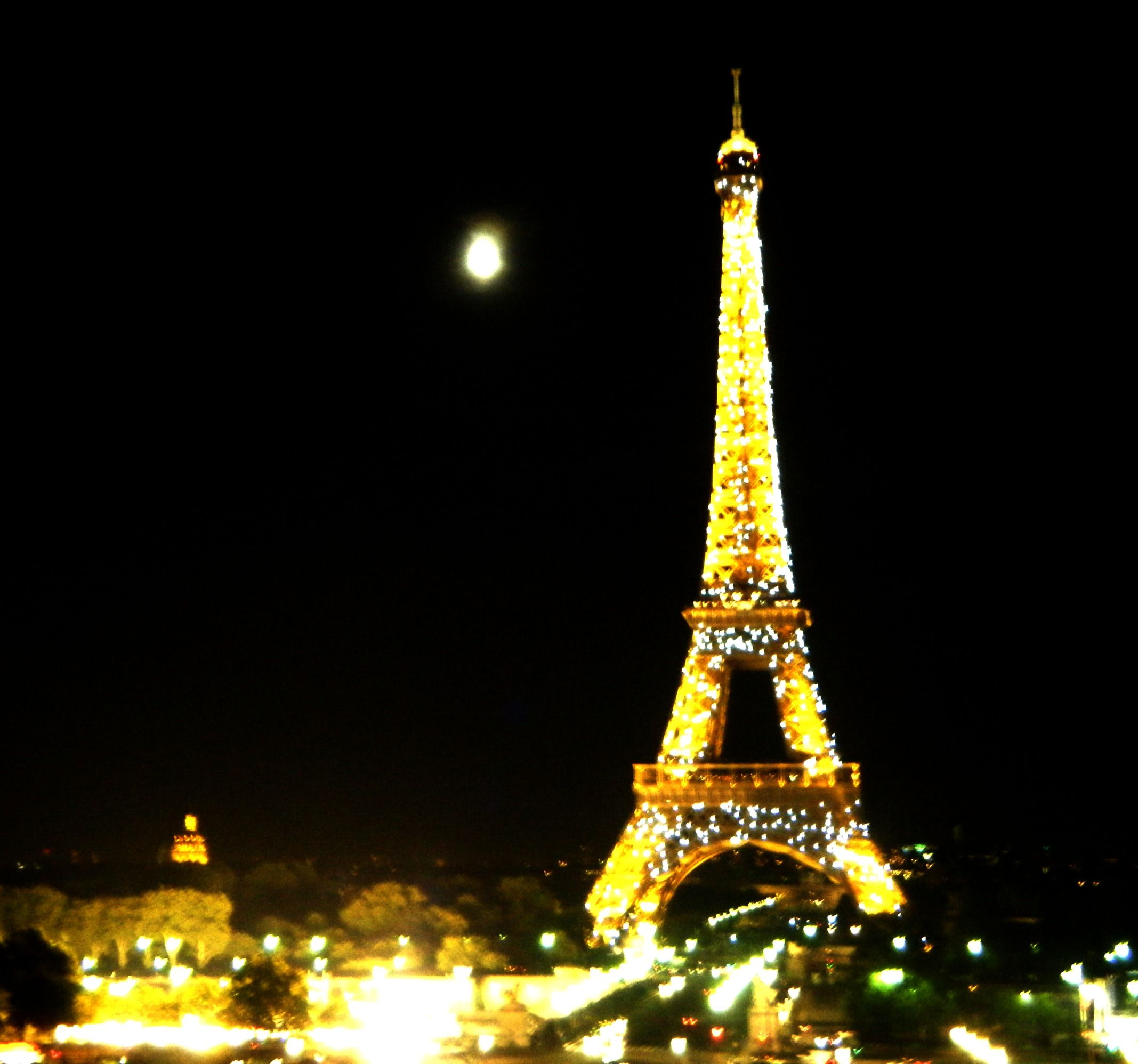 Full moon next to the Eiffel Tower.