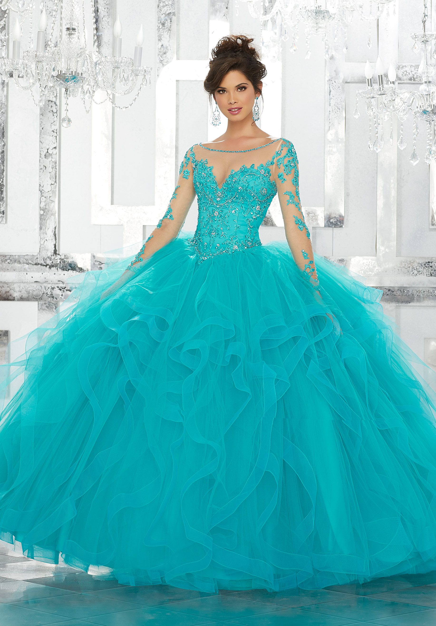 1cf97801d This Gorgeous Quinceañera Ballgown Features a Beaded and Embroidered Bodice  Accented with an Illusion Neckline and Long Illusion Sleeves.