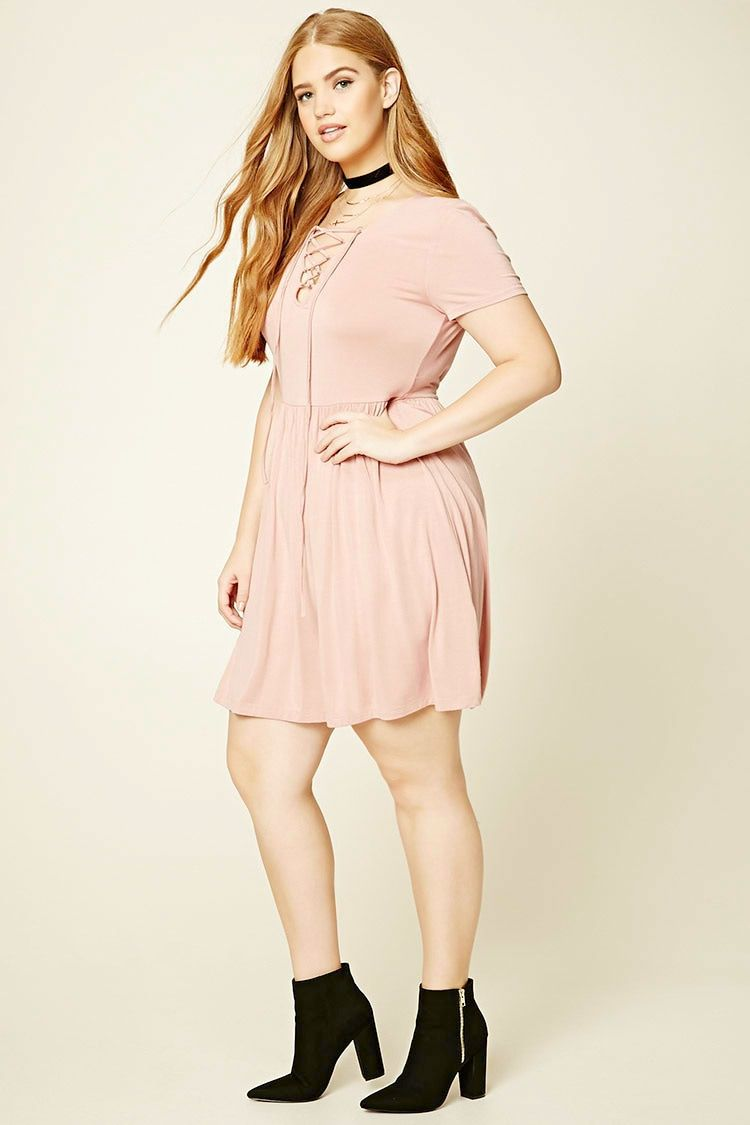 Forever a knit skater dress featuring a vneckline a laceup