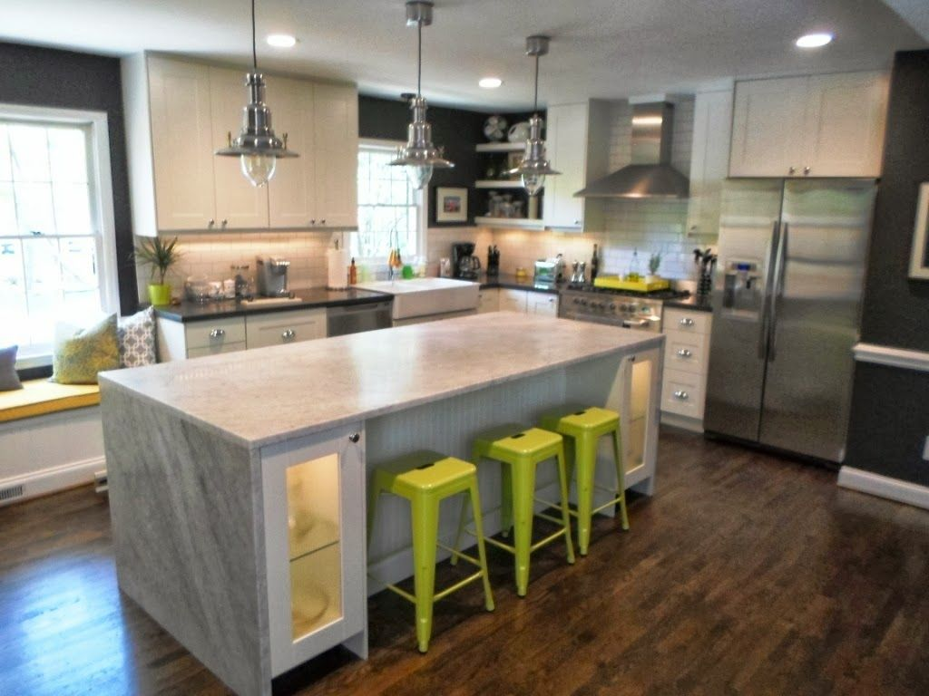 Nice Waterfall Countertop For Your Elegant Kitchen Decorating Ideas: Modern Kitchen With Waterfall Countertop And Bar Stools Also White Cabinets With Pendant Lights #waterfallcountertop