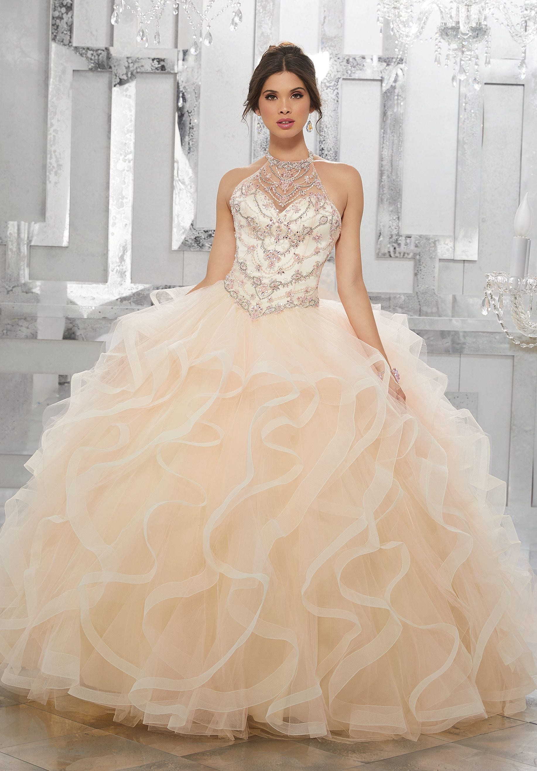 f5983447cd8 Tulle Quinceañera Dress Featuring a Beautifully Beaded Bodice and High  Halter Neckline with a Cascading Ruffle Skirt Trimed in Horsehair.