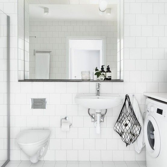 Neutral White Bathroom With Washer And Fish Net For Storing - Bathroom utilities