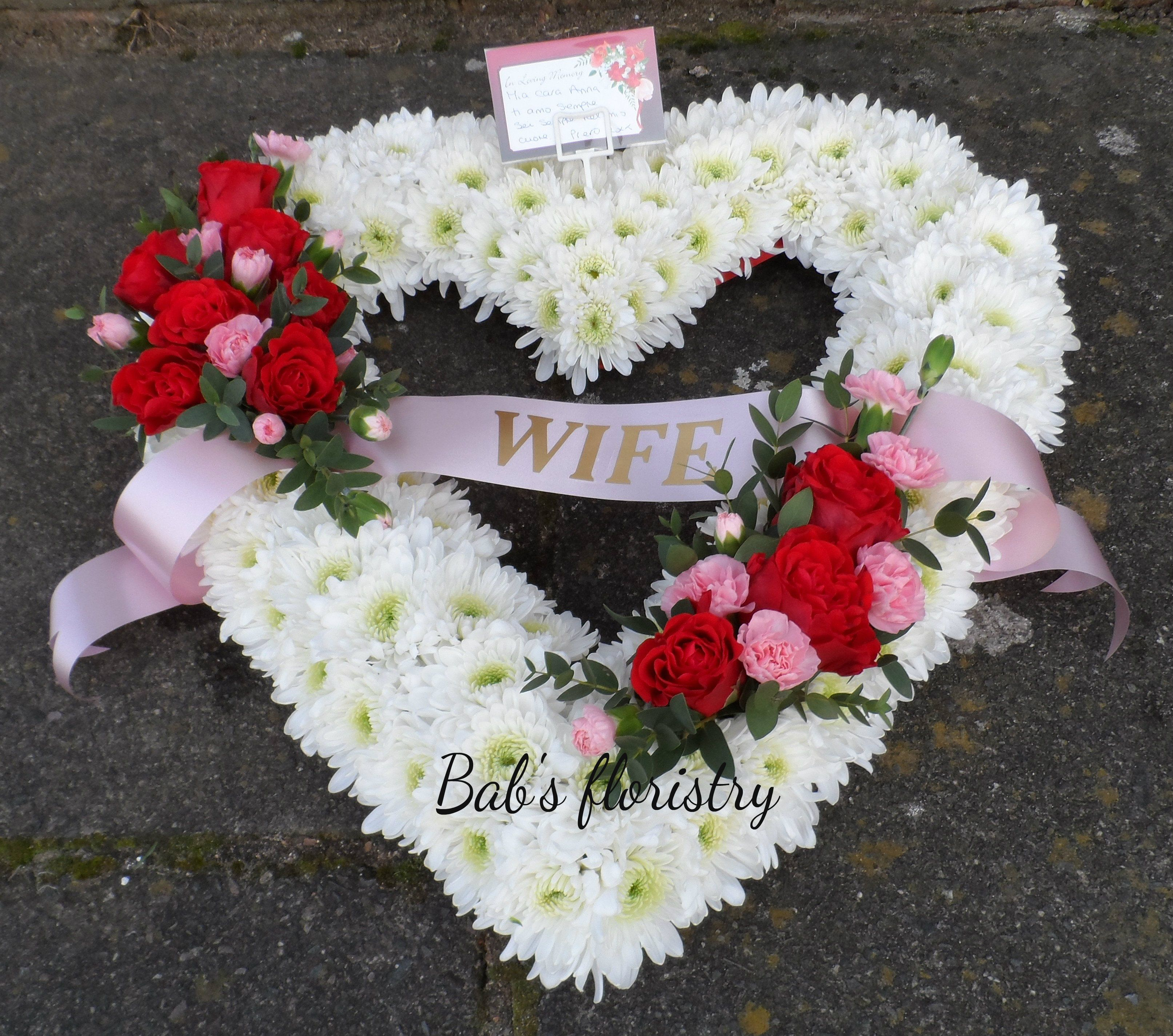 Open Heart Sympathy Tribute With Two Sprays Of Flowers On A Base Of
