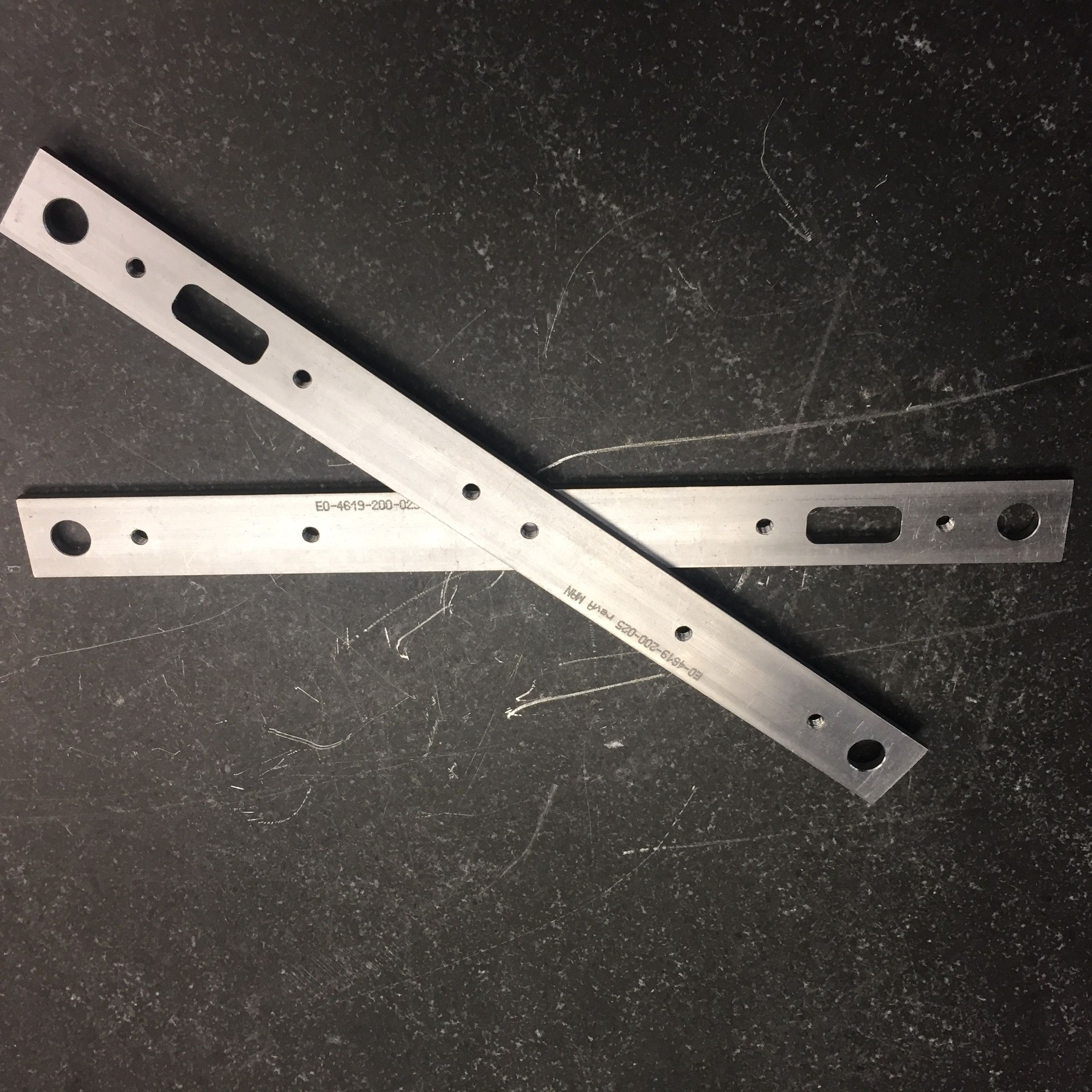 Long, machined aluminum bracket. #Manutec #MadeInUSA #MadeInAmerica #AmericanMade #MichiganMade #MadeInMichigan #Aluminum #MachinedAluminum #PrecisionMachined #CNC #CNCMill #PrecisionMilled #PrecisionMilling #Bracket #SupportBracket #MilledAluminum #Bridgeport #4Axis #3Axis #MultiAxis
