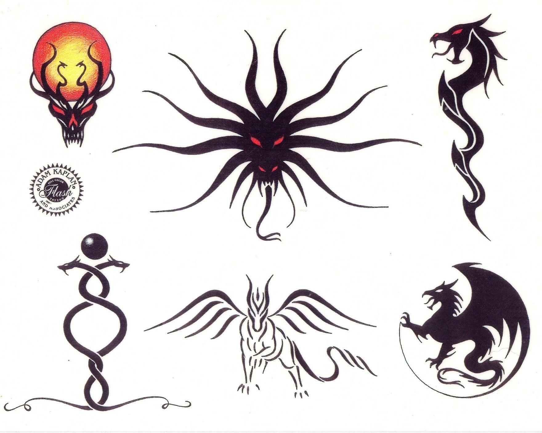 Small Tattoo Art: Small Tribal Dragon Tattoos