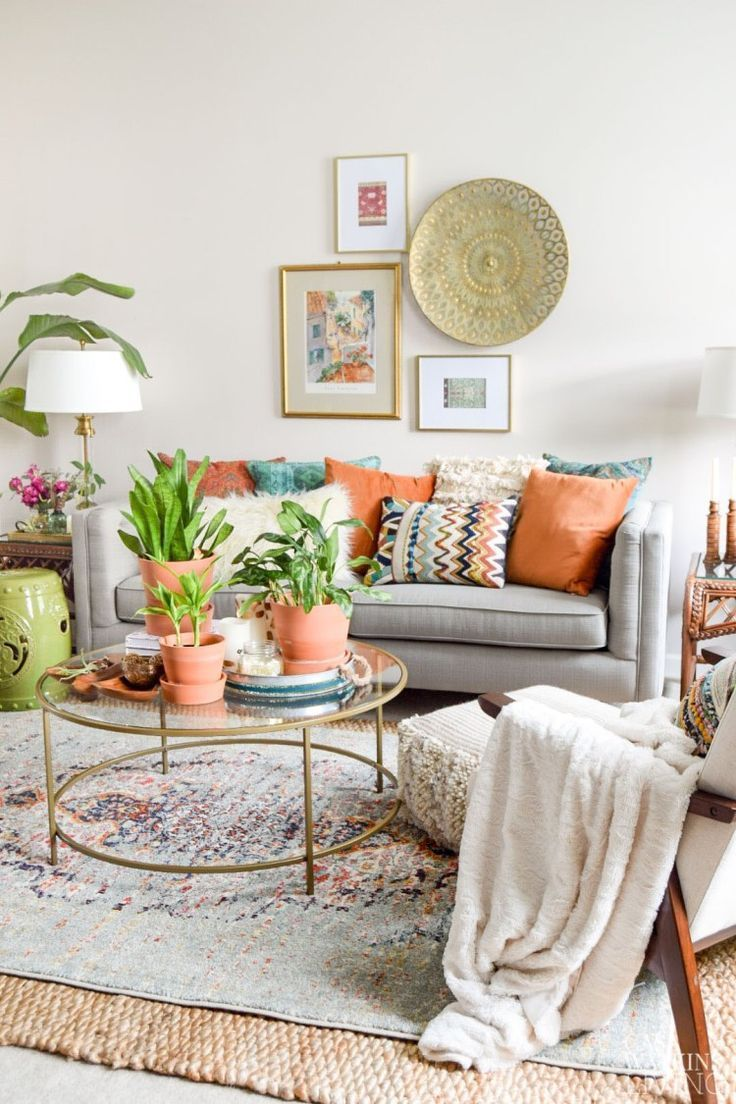 Global Style Living Room With Gray Sofa And Boho Style Pillows