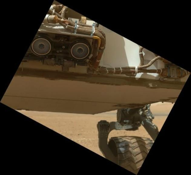 NASA's Curiosity rover inspects its belly.