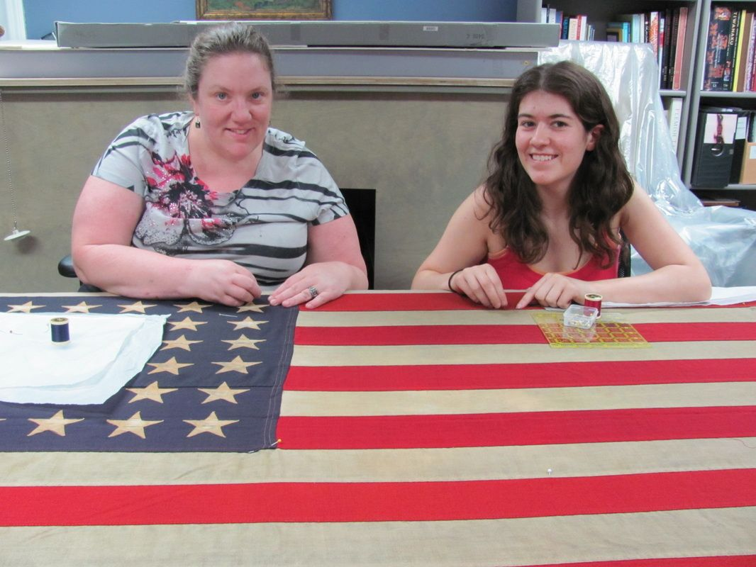 Camille And Courtney Mounting A Wwii Flag Image Courtesy Of Us