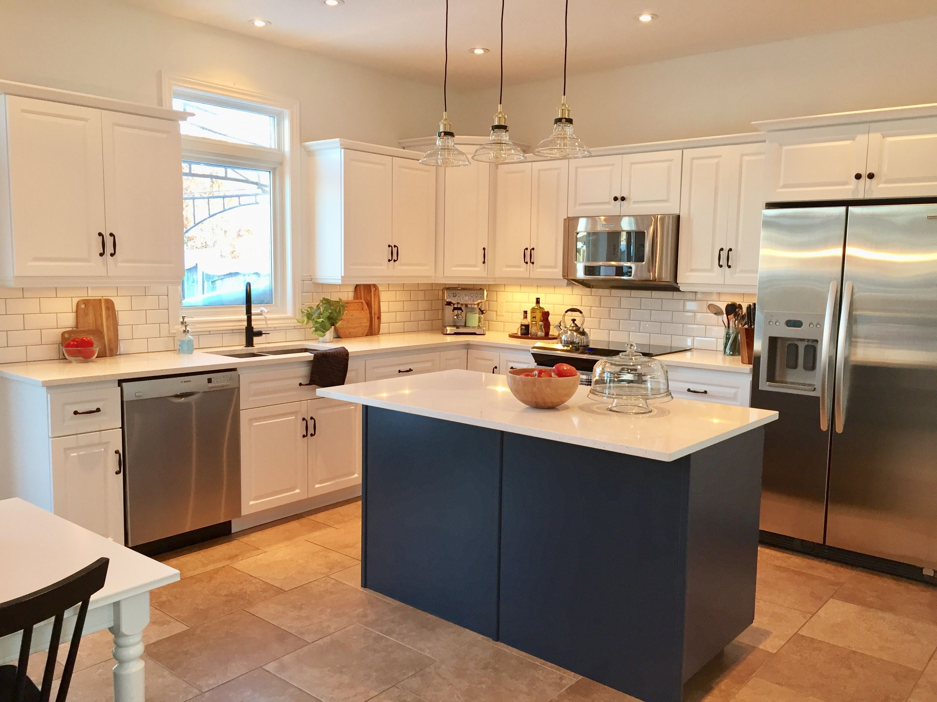 hale navy island, quartz counters, chantilly lace cabinets | val's