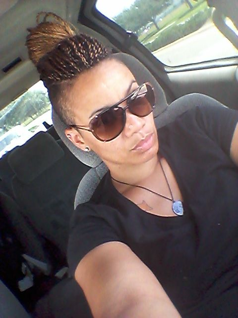 Long Twist Up In A Bun With Shaved Sides Blonde In Front
