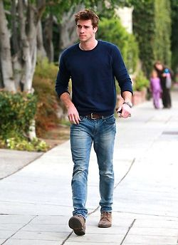 Navy blue sweater & deep brown belt with jeans.
