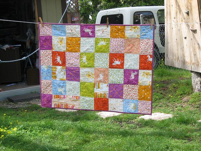 Far, Far Away Baby Quilt by oversewn, via Flickr - Love this!  Too bad the fabric is discontinued and way way expensive.
