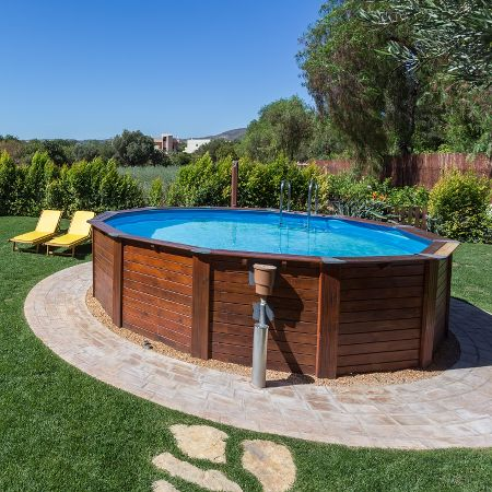 Above Ground vs Inground It's Not Just About Cost is part of Above ground pool landscaping, Best above ground pool, Above ground pool, Backyard pool landscaping, Round above ground pool, Backyard pool - Not sure what type of swimming pool to get  This article lays out all the factors in the ageold debate between above ground pools vs  inground pools