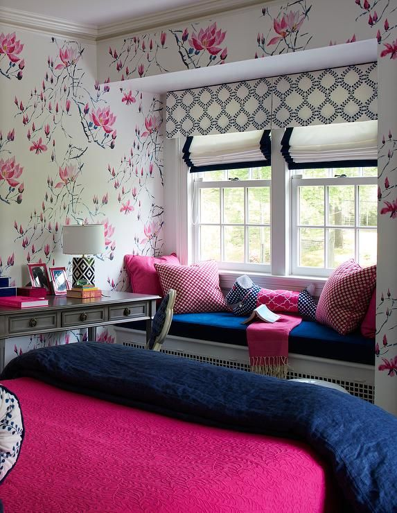 colorful pink and blue girls room features walls covered
