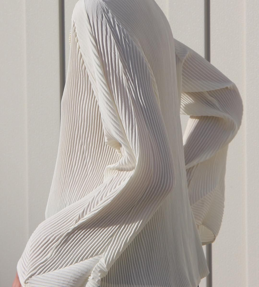 9402f9bd7d1e9 A cream micro pleated blouse featuring bell shaped sleeves. Shop at  www.michaela.co ~  michaelaco