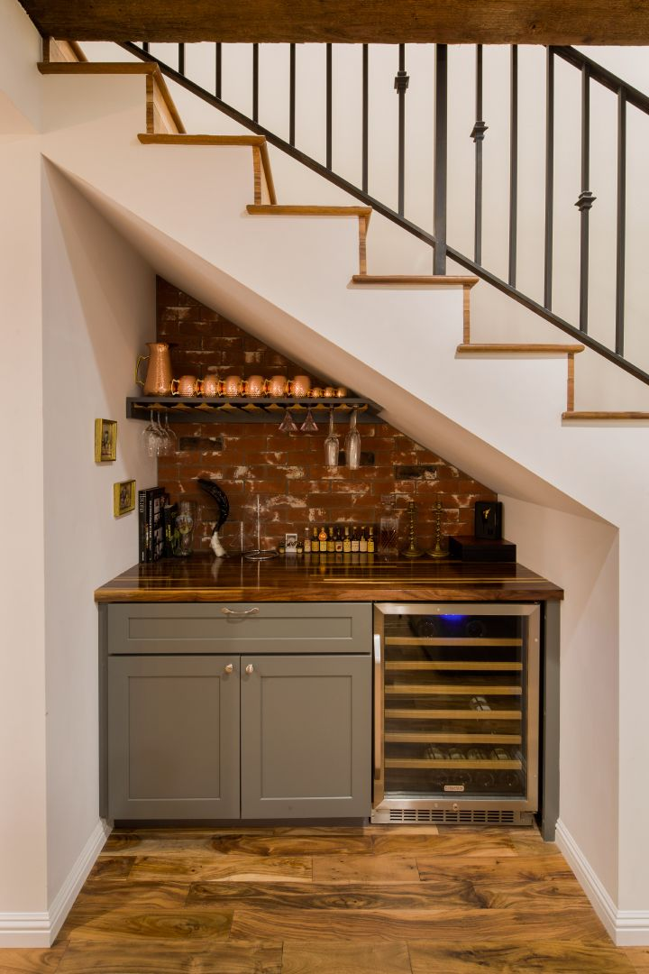 basement wet bar under stairs. Right after the entrance  on right overlooking living space The wall seen is den or powder room house Pinterest Dry bars