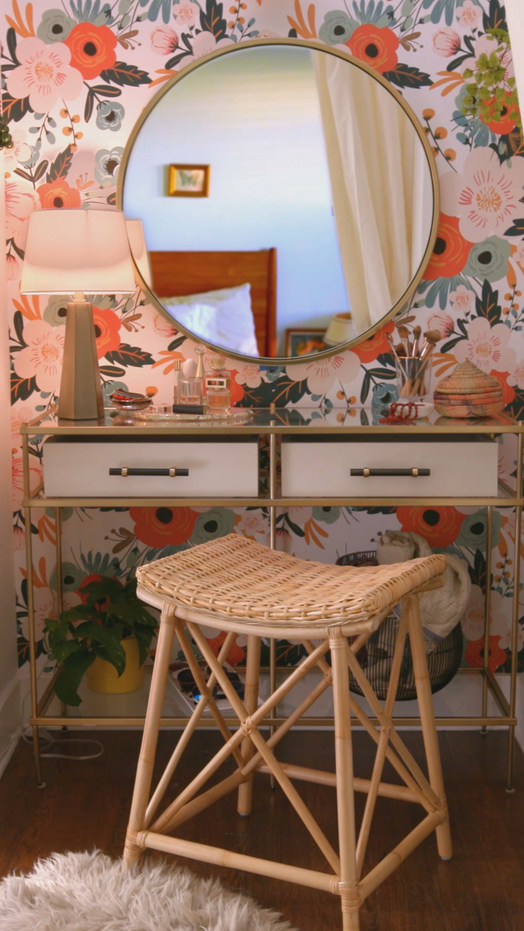 From an unorganized storage space to a stylish makeup station, see how we transformed this tiny nook with some statement-making wallpaper and chic finishing touches.
