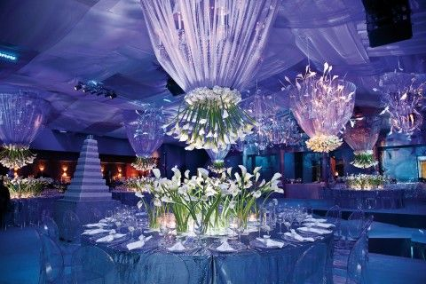 unique and modern wedding reception decor with upsidedown calla