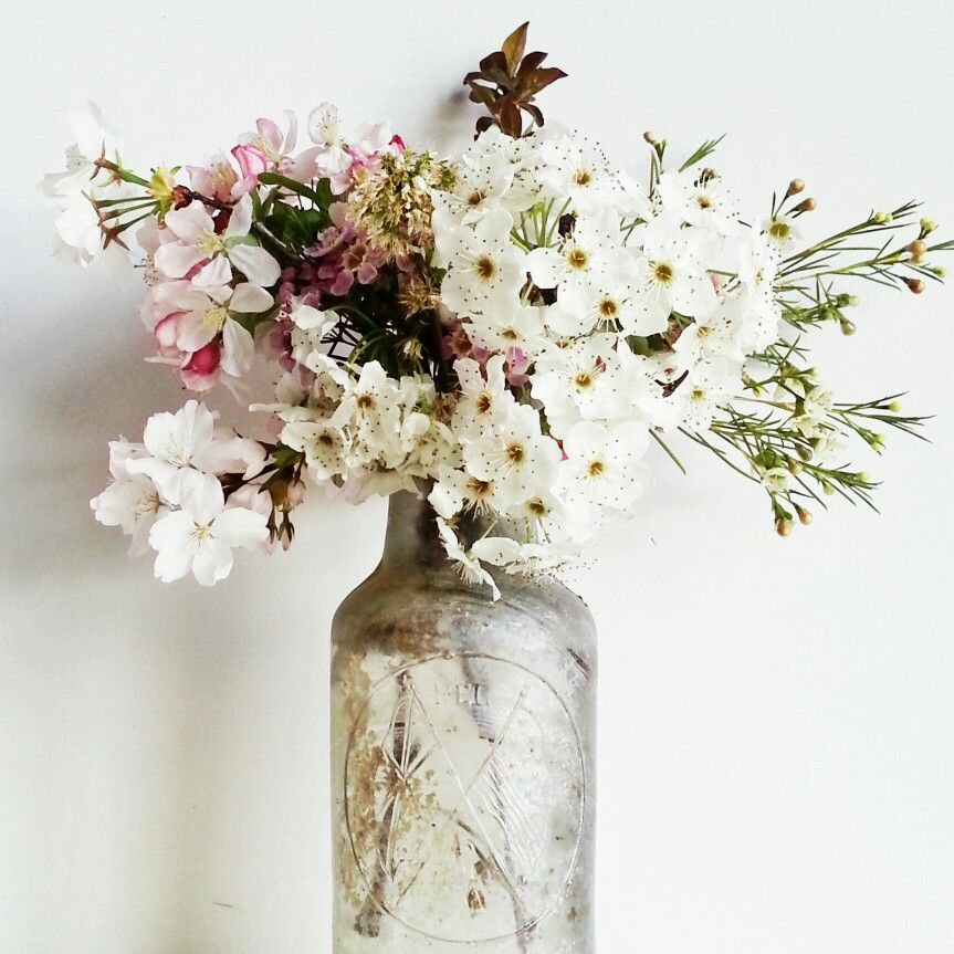 Spring blossoms  and salvaged bottle