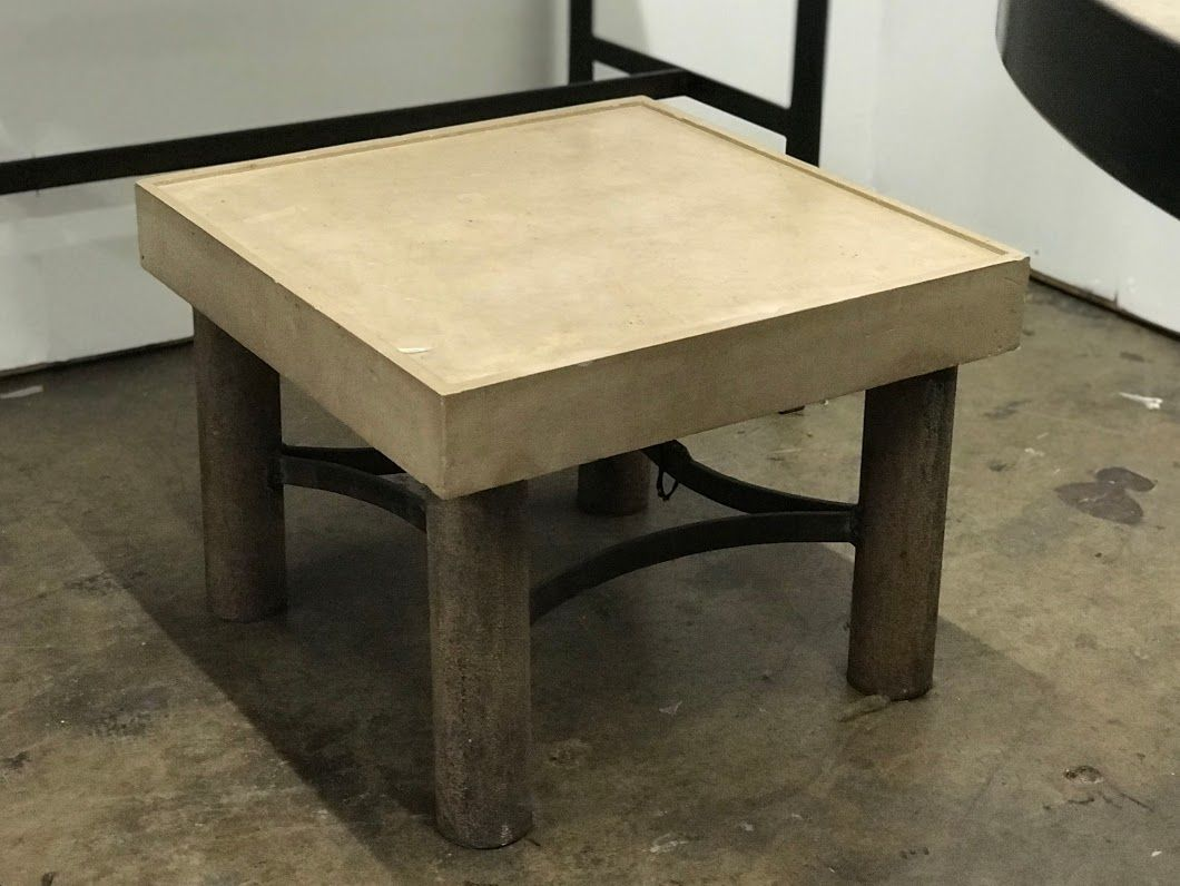 Cast stone and pipe iron base table dealer