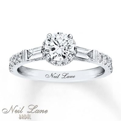 A stunning round diamond is framed by two beautiful baguette diamonds in this engagement ring from Neil Lane Bridal.