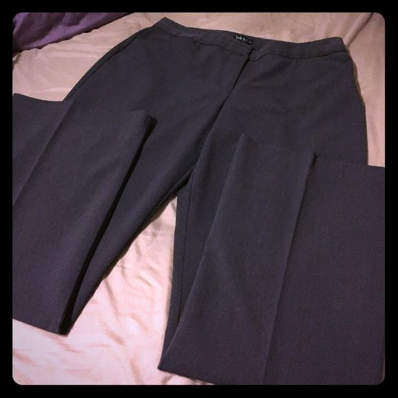 Nicole Miller Business Slacks Beautiful charcoal slacks worn two or three times. Great fabric and sits at waist.  Classic cut great for the office. Two functional front pockets and two faux pockets on back. No stains, holes, rips, or fading. Nicole Miller Pants Trousers