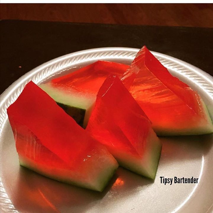 WATERMELON JELLO SHOTS Large Watermelon 12 oz. (360ml) Red Jello 8 Packets Gelatin 4 Cups Hot Water 2 Cups Vodka 2 Cups Cherry Vodka