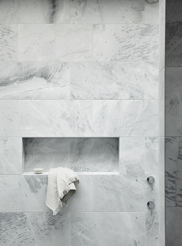 White Marble Tile Bathroom large marble-ish tile with an inset shelf in the shower. | home