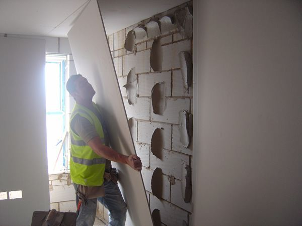 How To Plaster Board A Wall Using The Dot Dab System Drylining Cinder Block Walls Concrete Block Walls Basement Makeover