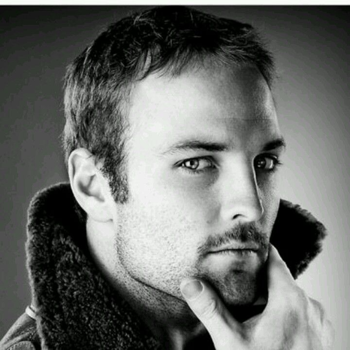 Wes Welker-former New England Patriot Football player. A black & white picture of him stroking hos goatee.