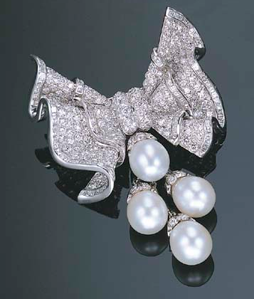 A SOUTH SEA CULTURED PEARL AND DIAMOND BROOCH  Designed as a pavé-set diamond bow with square-cut diamond trim, suspending a tassel of four cultured pearl drops , mounted in platinum and white gold.