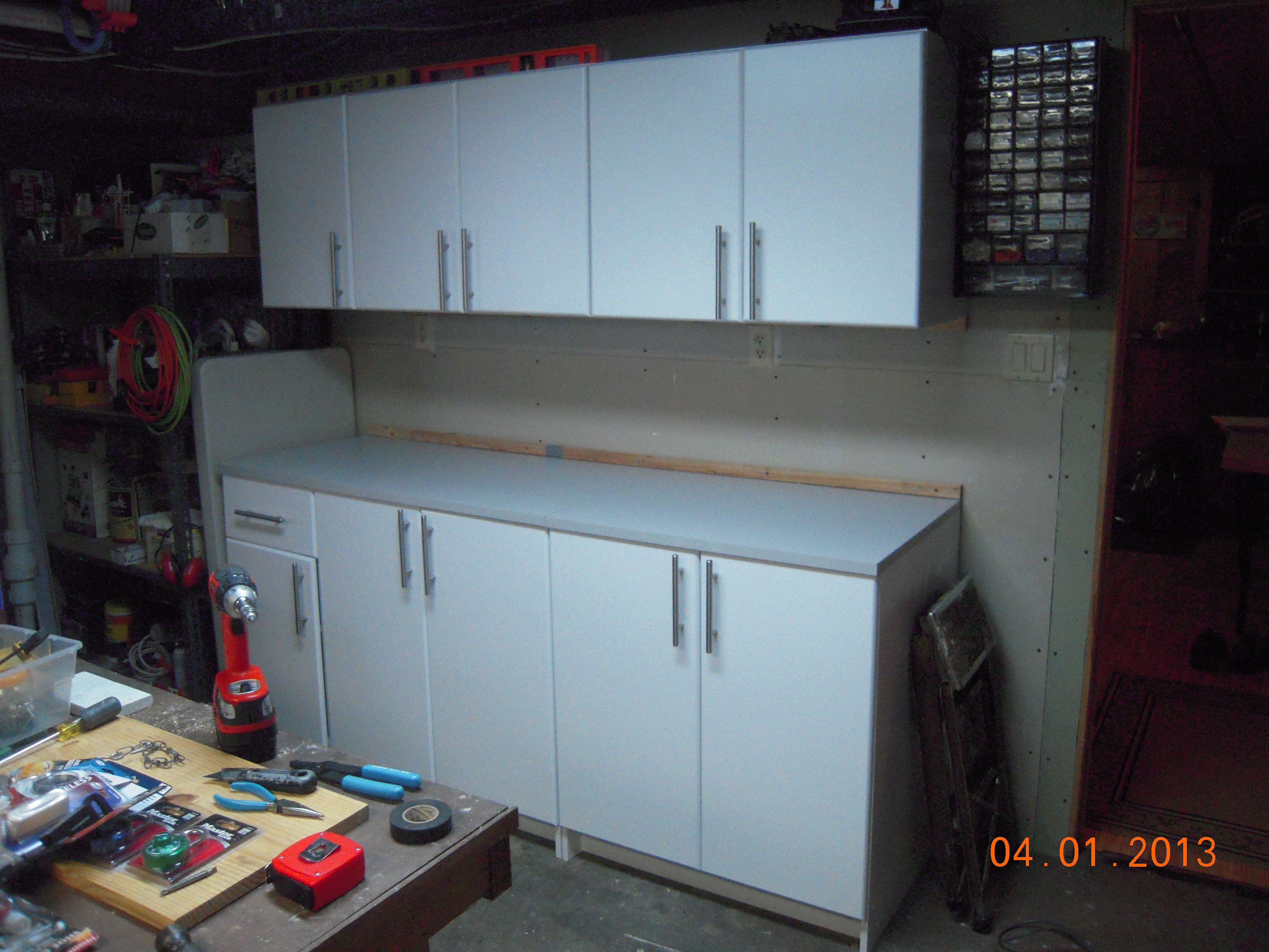 Step 4) All of the matching base cabinets are installed below the wall cabinets