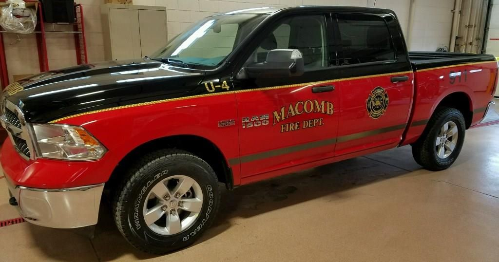 install black and gold leaf decals on a black red 2 tone dodge ram for macomb fire fire department car decals fleet vehicles install black and gold leaf decals on a
