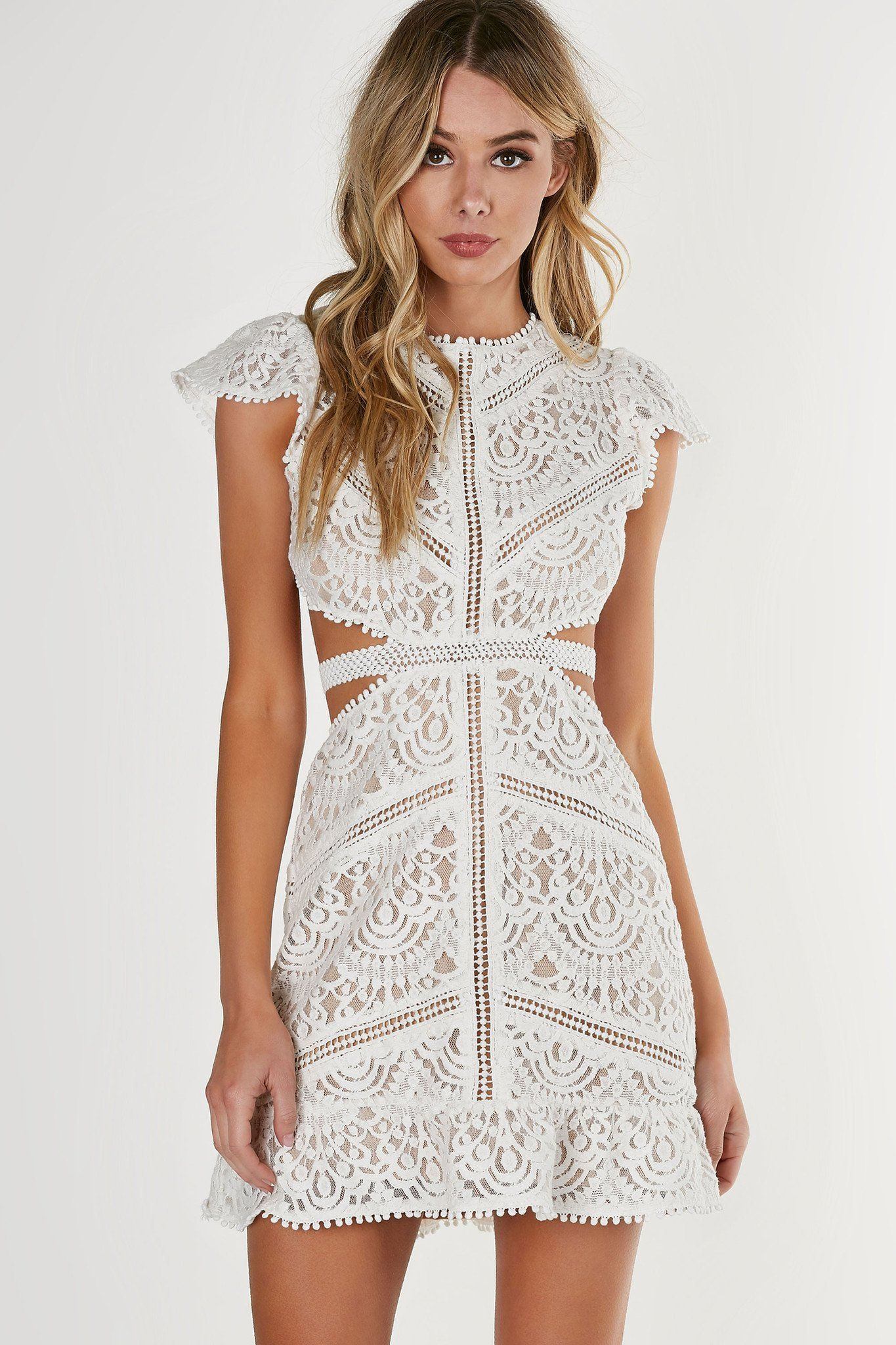 967331e442 Round neck short sleeve dress with flirty A-line hem and cut outs at waist.  Open back with a button closure. Intricate crochet overlay with full lining.