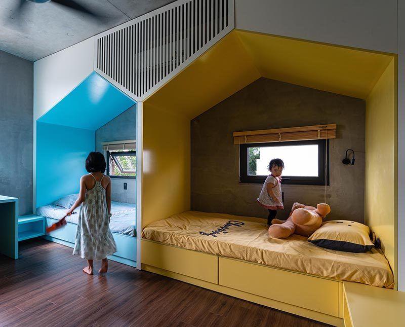 Shared Children S Bedroom Has Two Little Houses Built In Minimalist Bedroom Design Minimalist Bedroom Modern Kids Beds