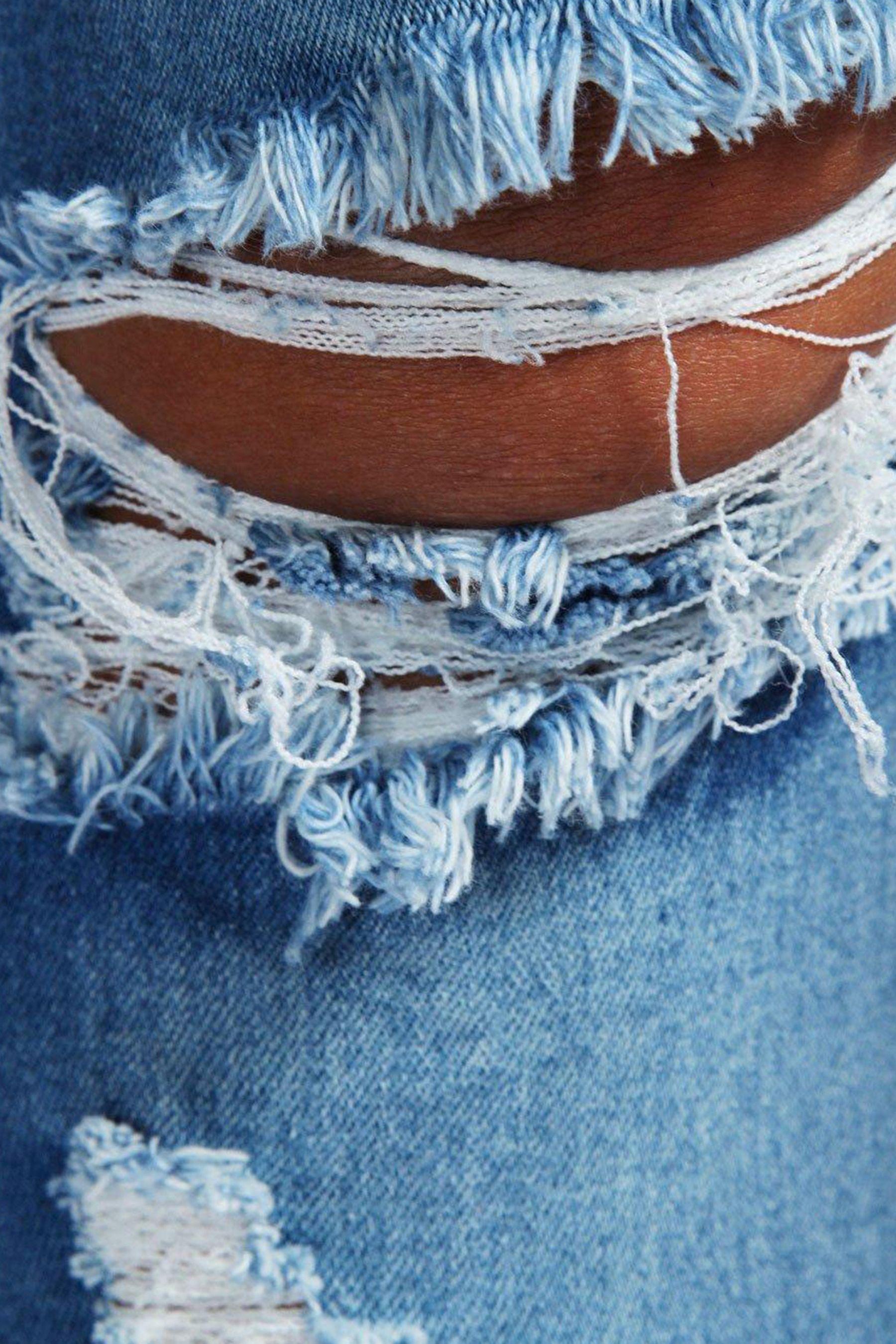 e96c25186e Womens Boohoo Low Rise Distressed Rip Knee Skinny Jeans - Blue ...