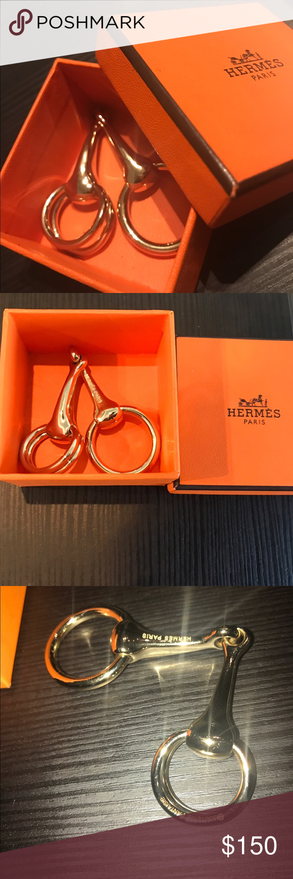 """Hermes """"Bijouterie Fantaisie"""" Horsebit Scarf Ring Authentic Gold Toned Hermes """"Bijouterie Fantaisie"""" Horsebit Scarf Ring. This Authentic Hermès Gold Tone Horse Bit Scarf Ring is pristine. The equestrian design can be used in a multitude of ways to show off a scarf or shawl around the neck or the waist. Original Box included Hermes Accessories Scarves & Wraps"""