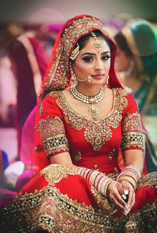 Beautiful Traditional Red And Gold Bridal Lehenga
