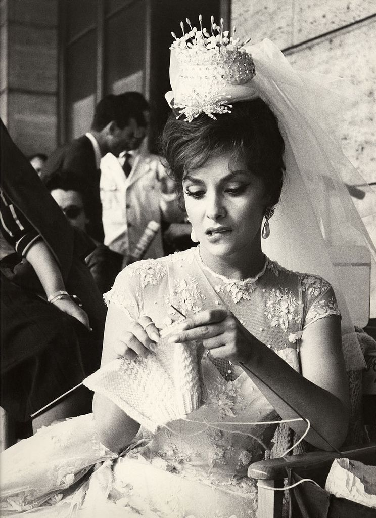 knitting... if this is her wedding day, I'm not sure why she's knitting during it... but who knows? I might just do the same thing.