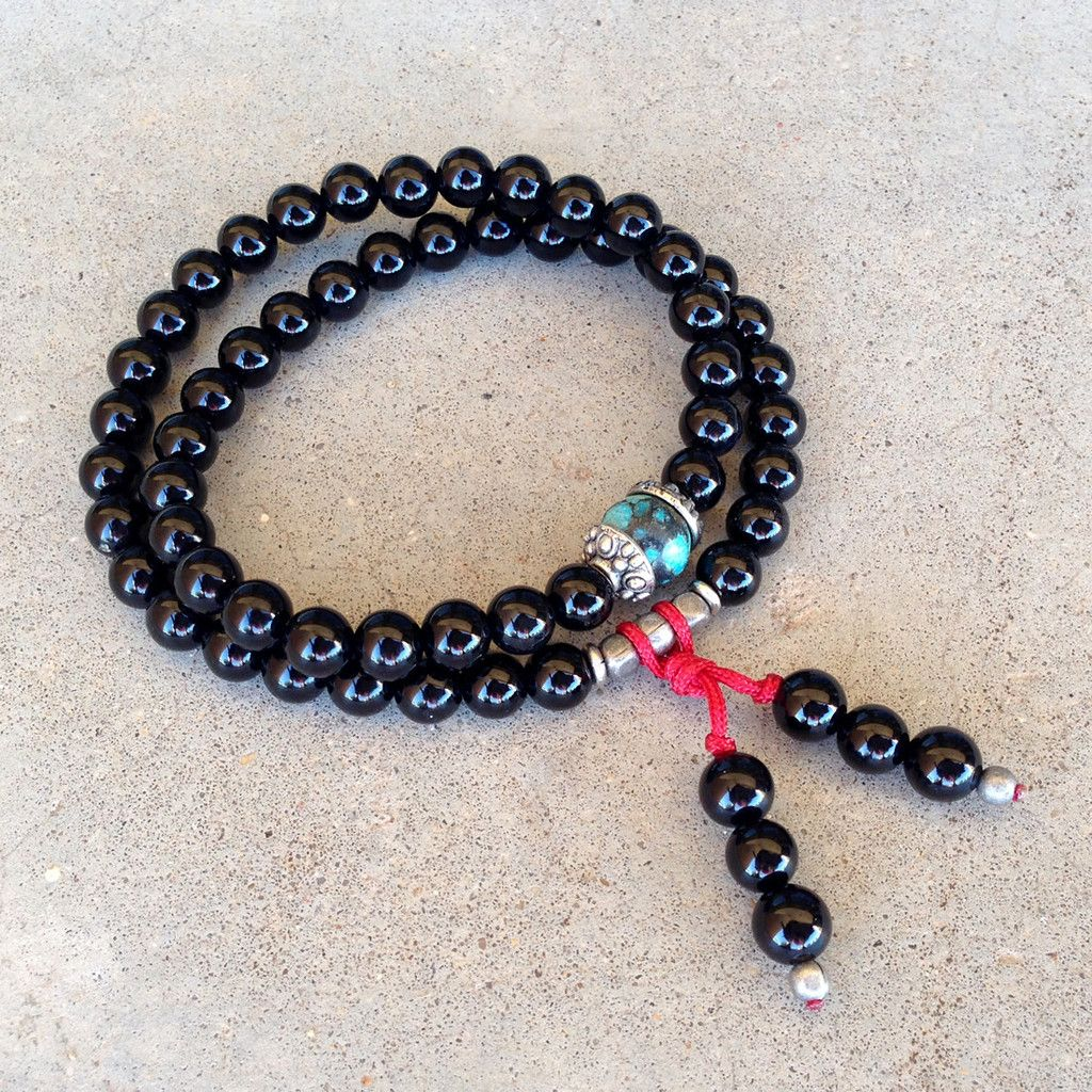 54 bead mala, made with genuine onyx, in the middle a genuine turquoise bead and with hi-tec elastic, that will stretch and allow you to use it as a wrap bracelet! (We add tiny metal beads to increase