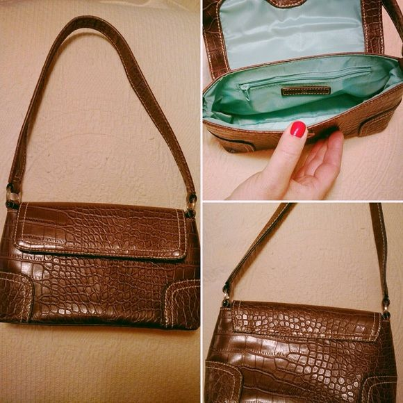 Tommy Hilfiger minibag Tommy Hilfiger deep chocolate brown leather mini bag.  Turquoise lining.  In great shape! Tommy Hilfiger Bags Mini Bags