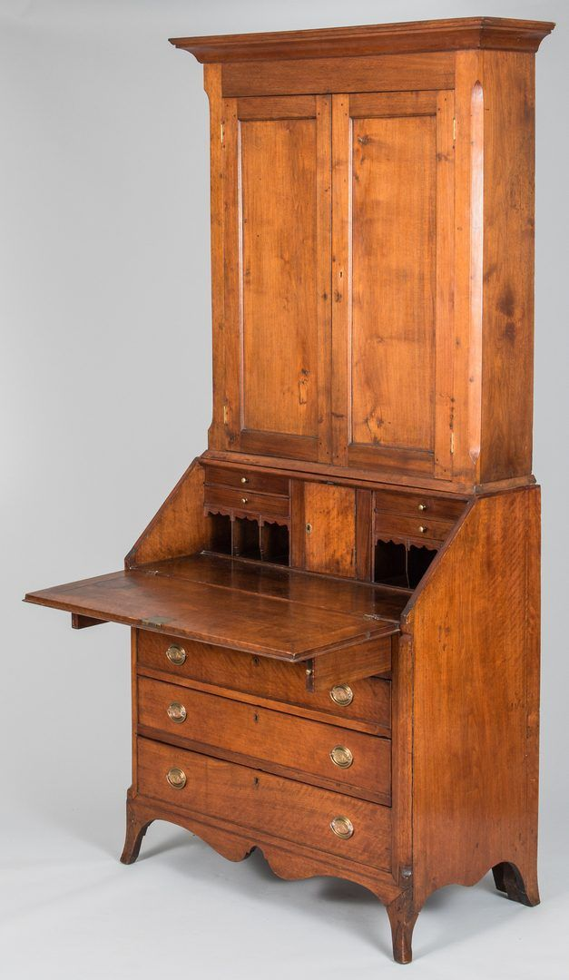 """East Tennessee Federal desk & bookcase or secretary, figured walnut with poplar secondary wood. Bookcase section with cove molded cornice over a plain frieze & two single paneled doors, flanked by chamfered corners; 3 interior shelves with plate grooves. Diamond inlay at keyhole, molded base. Desk section with fall front, battened top & sides, opening to fitted interor with central plain prospect door...94"""" H x 42"""" W x 21 1/2"""" . Provenance: The estate of Dr. & Mrs. Ben Caldwell, Nashville…"""