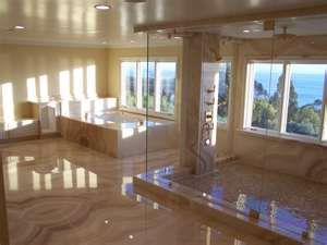 This bathroom is so spectacular. Reminds me of a spa. I like how spacious, and open the concept is.