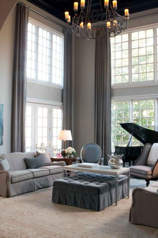 Window Treatments Light Grey Silky Satin High On The Ceiling Curtains With Silver Iron Curtain Rods Candle Chandeliers Over Top Sofa