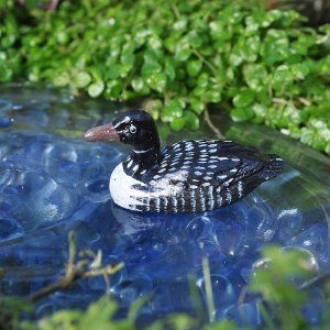 """Miniature Fairy Garden Little Loon by Animals. $2.59. size: 1.5"""" Long x .75"""" High. material: Resin. Spending long periods motionless on the water is the distinctive black-and-white patterned loon. In the midst of a miniature garden, what a nice addition the Little Loon makes to a translucent Frog Pond. Raindrops peeking out from underneath the pond create the illusion of rippling water. Place a few Raindrops on top of the pond to create a water puddle effect. Nesting lakeside ..."""